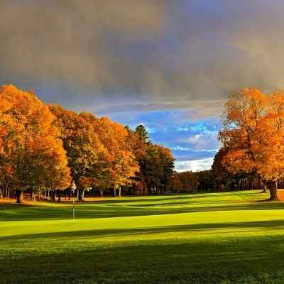 Golf course with fall colored trees